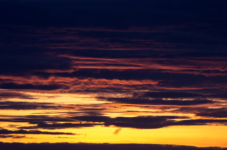 emphasize: Sky during sunset. Emphasize the textured clouds.