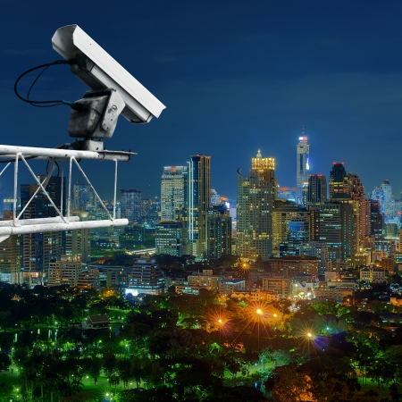 Security cameras monitor the movement of the top of the building, Aerial view of Bangkok. photo