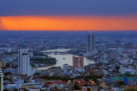 Landscape of Bangkok. Along the Chao Phraya River. Stormy rainy evening. photo