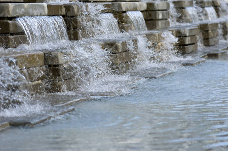 water feature: Artificial Waterfall . Decorations in the garden. Stock Photo