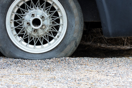 Close up of a flat tire, old classic cars. Stock Photo