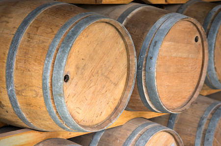 Close up wooden wine barrels in warehouse  photo