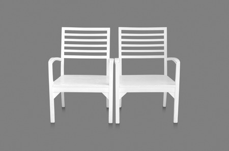 White chair isolated on gray background with clipping path. photo