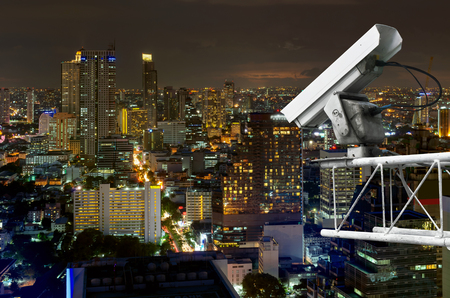 Outdoor security cameras on high towers. Set against the high corner of Bangkok. photo