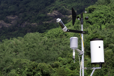 hygrometer: Wind speed measurement devices Against a backdrop of green trees on the mountain. Stock Photo