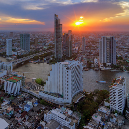 Landscape modern building near the river at sunset in Bangkok view of the bird. Stock Photo