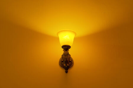 lamp shade: Wall lamp with yellow shade from glass.