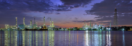 Panoramic oil refinery factory at Twilight. Chao Phraya river in Bangkok, Thailand.