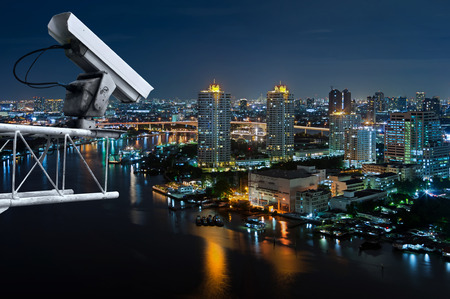 Security cameras monitor the movement of the top of the building, Aerial view of Bangkok along Chaophraya River.