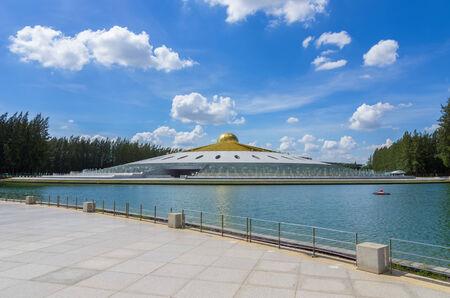 thani: PATHUM THANI - 13 MAY : a bright sky UFO shaped pagoda at Wat Dhammakaya May 13, 2014 in Pathum Thani, Thailand. Editorial