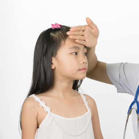 body temperature: Asian girl sick body temperature was measured using a hand touching the forehead. Stock Photo