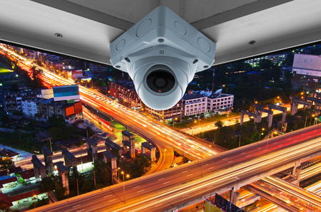 The security cameras on a balcony high building. View traffic at night photo