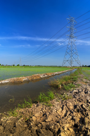 electric grid: High voltage electricity pylon on bright sky. Stock Photo