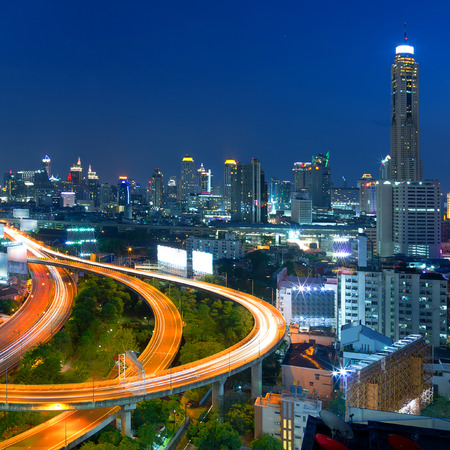 front elevation: Building the business district in the evening Front elevation curves of the highway bridge in Bangkok.