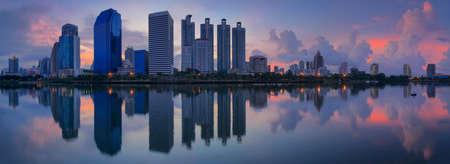 benjakitti: Landscape panorama skyscraper business district at dawn sky, beautiful water reflection. Stock Photo