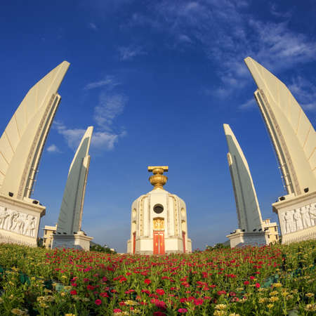 democracy Monument: The Democracy Monument beautiful sky There is a foreground flowers (Bangkok, Thailand).