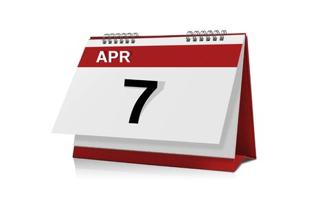 desktop calendar: April 7 desktop calendar isolated on white background with clipping path. Stock Photo