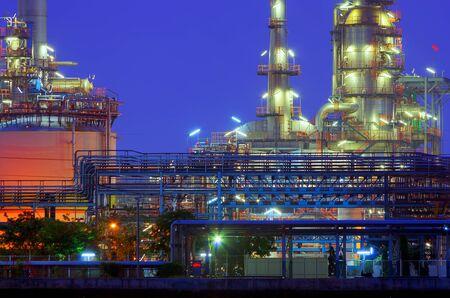 Oil refinery factory at twilight Chao Phraya river in Bangkok, Thailand. Imagens