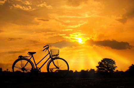 stationary bike: Silhouette stationary bike at sunset sky beautifully.