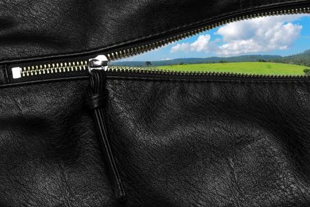 unzip: Zipper open concept with a background of natural landscape.