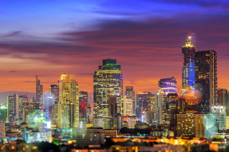 combines: Bangkok business district during twilight sky dramatic with blurred light, Concept combines multiple exposures with bokeh.