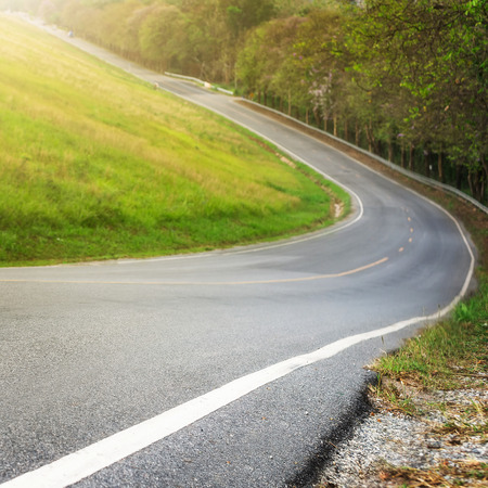 gear  speed: Steep road. Reduce speed and use a lower gear. Drive with caution. Stock Photo
