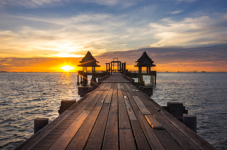 tourist attraction: Landscape of wooden bridge in the port and the sunset.