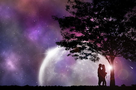 night out: Silhouette Couple and tree, with beautiful night sky, Concept looking out to the outside world.
