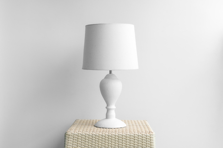 bedside lamps: Lamp on a night table next to a bed. Stock Photo