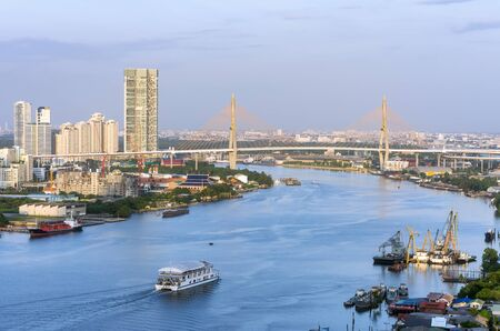 industrial district: Boat on the river With the backdrop Bhumibol Bridge And the industrial district.