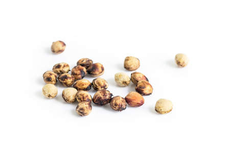 pits: cherry seeds isolated  on a white background.