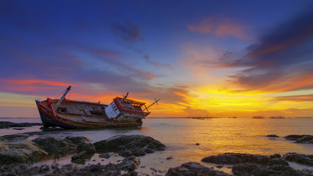 Seascape with old derelict fishing boat Stock Photo