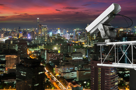Outdoor security cameras on high towers. Set against the high corner of Bangkok.