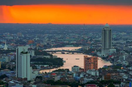 Landscape of Bangkok. Along the Chao Phraya River. Stormy rainy evening, HDR Images.