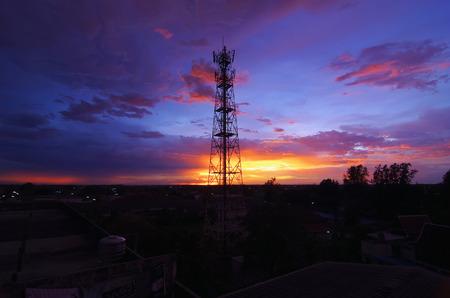Silhouettes telecommunication tower at sunset. Beautiful sky.
