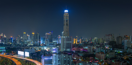 front elevation: Building the business district in the night Front elevation curves of the highway bridge in Bangkok.
