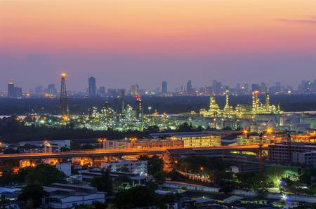 Landscape oil refinery factory at twilight, near Chao Phraya river in Bangkok, Thailand.