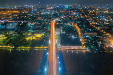Birds Eye View, Landscape view of the Rama VIII Bridge. The view along the road straight into the city. Building the business during the night.