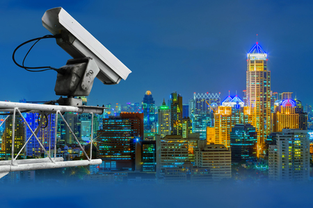 The security cameras on a balcony high building. City view at night