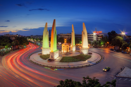 Blurred lights and traffic lights Twilight time at the Democracy Monument in Bangkok, Thailand.