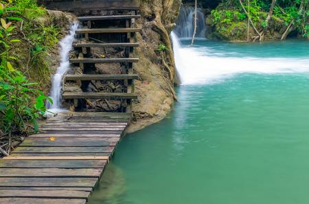 Wooden walkway along the Huai Mae Khamin waterfall. Kanchanaburi, Thailand. Stock Photo