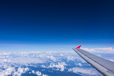 The view from the plane of the world under a cloud. Stock Photo
