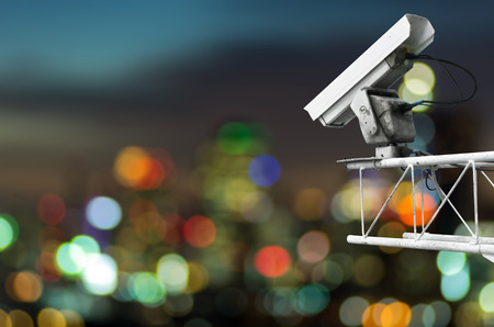 CCTV monitoring, security cameras. Backdrop with Cityscape view with blurred lights. Stock Photo