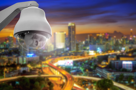 traffic controller: CCTV cameras, security cameras. With the backdrop tail lights blurred on the road from a high angle. Stock Photo
