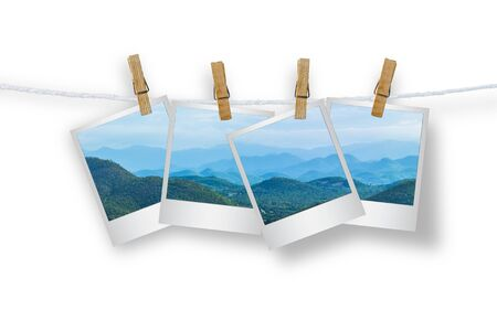 rolling landscape: Clothespin hanging with photo mountians, Isolated on white with clipping path.