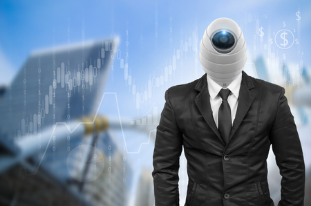Suit with security camera head with financial graph and network on blurred building background.