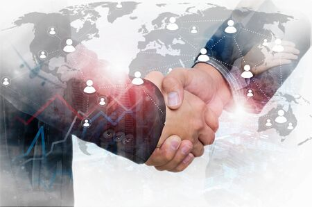 Double exposure of businessman handshake on industrial business background, connections concept, Elements of this image furnished by NASA.