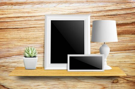 furniture store: Empty picture frame isolated , lamps and potted cactus on bookshelf  - For product display.