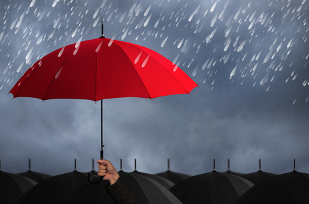 Red umbrella that protects against rain, concept insurance.