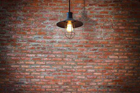 wall light: Vintage metallic lanterns, Decorative antique edison style light bulbs against brick wall background.